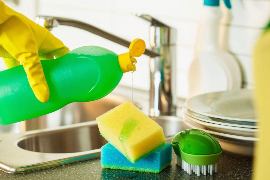 63694519_m-1024x683 - pouring dishwashing liquid on sponge kitchen wash cleaning