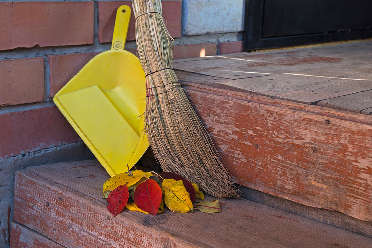 broom and dust pan outside